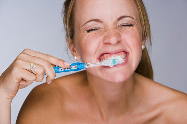 Woman-brushing-her-teeth-1586021
