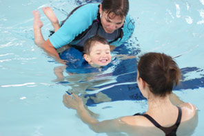 nia-teaching-a-todler-to-swim-to-her-mother